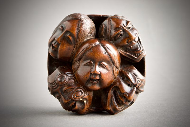 A Japanese netsuke of Nōh and Kyogen theatre masks