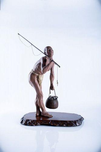 A Japanese Iki-ningy� sculpture okimono of a fisherman