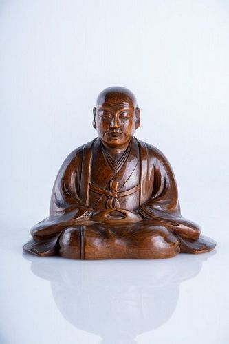 A Japanese okimono of a Buddhist