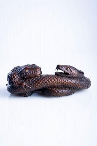 Ryonaga - A Japanese boxwood okimono of a toad with a snake