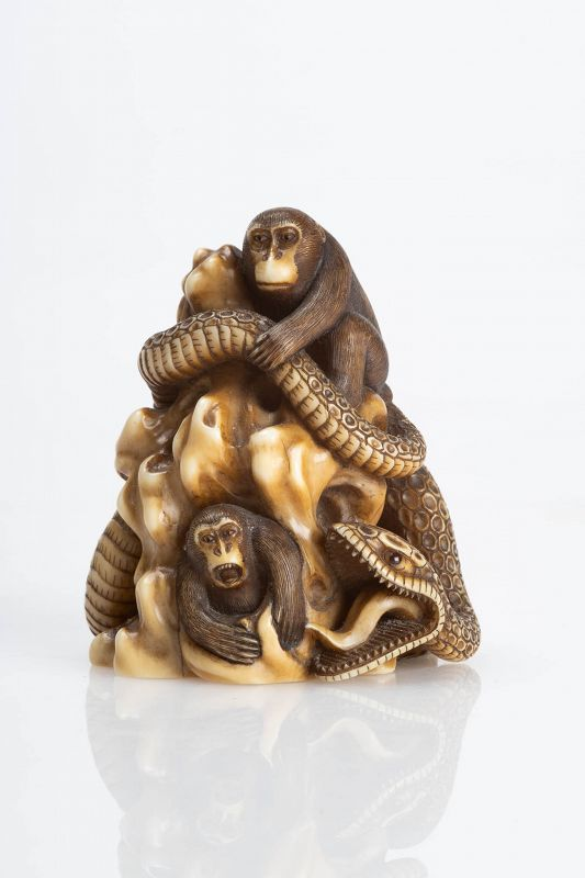 Shoichi - A Japanese okimono of two monkeys with a giant snake