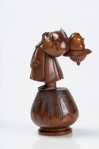 A Japanese boxwood okimono of a child