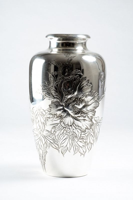 A Japanese silver vase