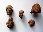 Group of Five Egyptian Terracotta Heads, Hellenistic to Roman