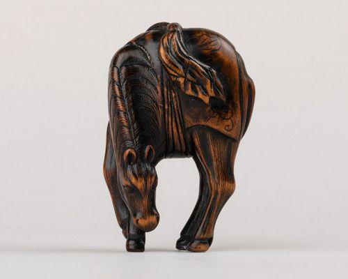 Netsuke wood - A grazing horse. Japan Edo 18th