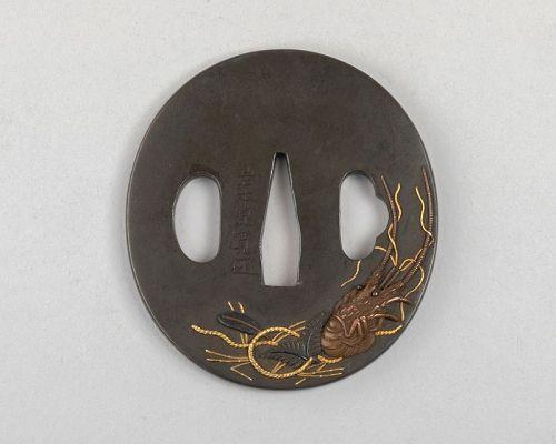 Tsuba by Iwanoto-konkan decorated with crayfish, Japan Edo 18th