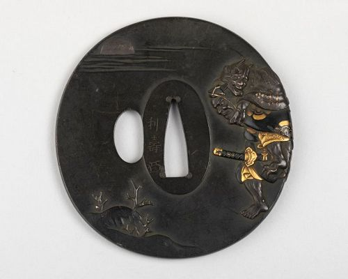Tsuba by Toshinaga- Hiko-Shichi the witch Chichaya on his back