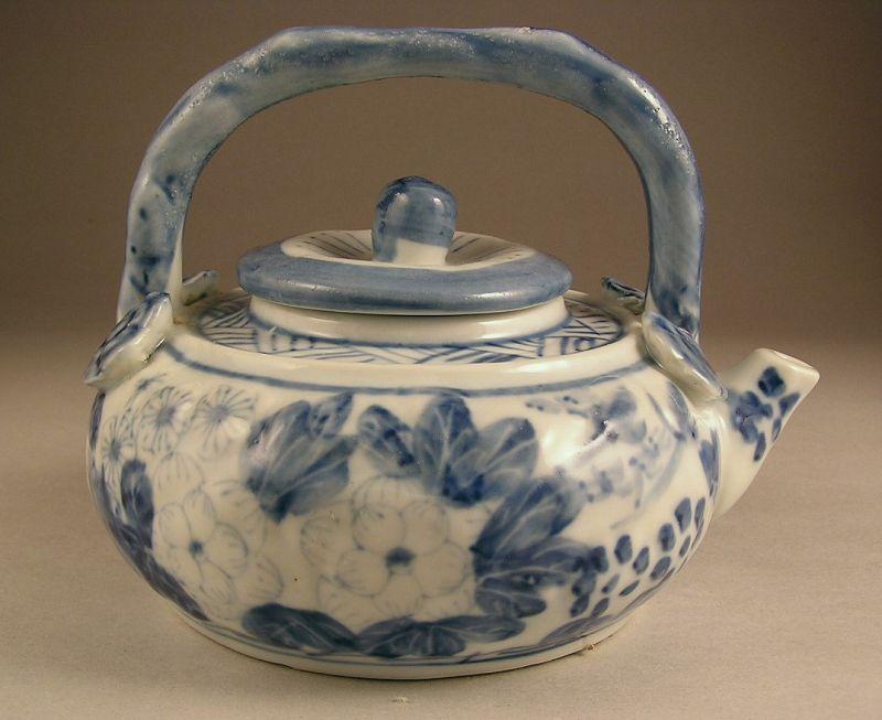 Unusual Japanese Porcelain Tea Pot with Flower Design
