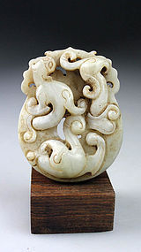 A beautiful white and celadon Chinese jade Dragon Bi disc!