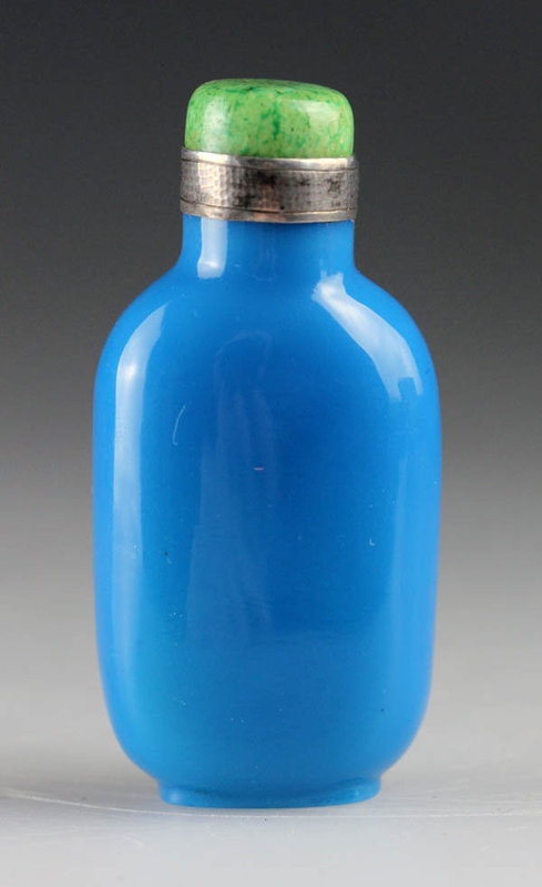 A persian turquoise silver mounted Chinese blue glass snuff bottle