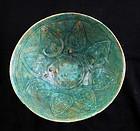 Rare carved Islamic greenish-blue pottery bowl, Seljuqs