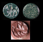 Scarce Neo-Babylonian green intaglio seal of a Griffin, 6th. cent. BC