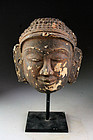 Rare large Burmese 'Stucco over Terracotta' Buddha head, 16th.-18th.