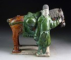 A fully glazed Chinese Ming Dynasty tomb pottery horse with groom!