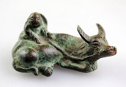 A nice small Vietnamese bronze figure of bull, Tran Dynasty