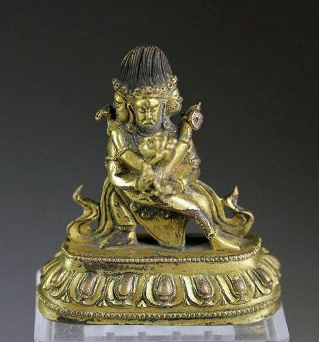 A fine Gilt bronze figure of a standing Deity, Sino-Tibetan!