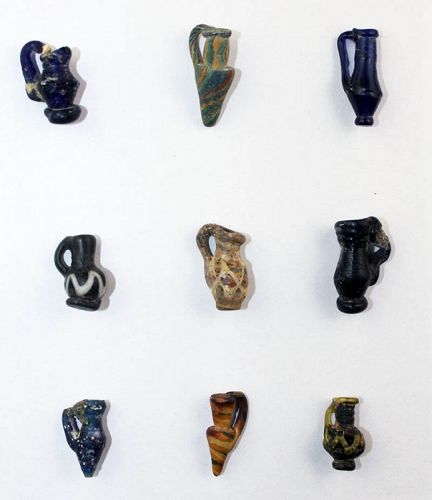 Rare collection of 9 Roman Rod formed glass vessels, 3rd. century AD!