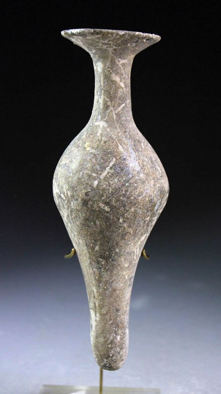 Large Roman free form glass bottle, 1st.-3rd. century AD