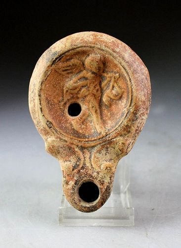 Early Roman pottery oil lamp with Amor and workshop mark, 2nd. cent!