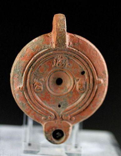 Superb Roman Terracotta lamp with theatre masks, 1st. century AD