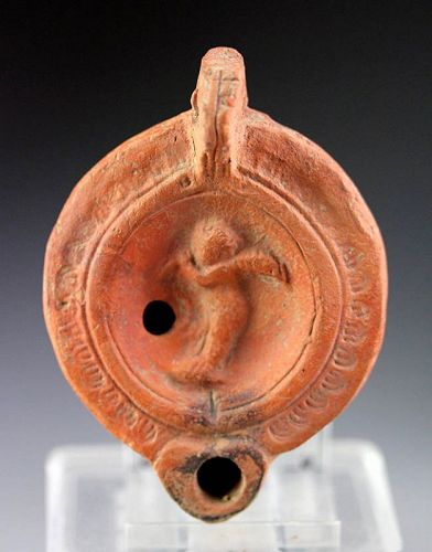 Choice Roman Terracotta lamp with Cupid, 1st. century AD