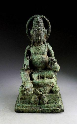 Rare Seated bronze figure of Kuvera or Kubera, Javanese, 10th. cent
