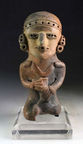 Large pottery figure of a seated Dignitary, Mexico, 500 BC-500 AD