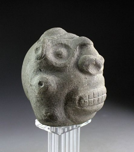A superb pre-columbian stone head of the Taino Culture, 1000-1300 AD.