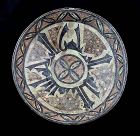 Large Islamic pottery dish w Cufic caligraphy, Nishapur 10th. cent.