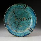 Beautiful Torquise glazed Islamic pottery Dish, Kashan, ca. 12. cent.