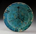 Fine Torquise glazed Islamic pottery Dish, Kashan, ca. 12. cent.