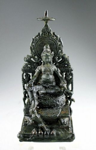 Superb Hindu bronze figure of Kuvera, Javanese, ca. 10th. cent