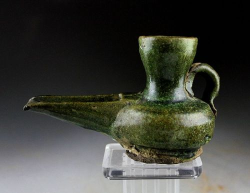 Islamic green glazed pottery oil lamp, 10th � 12th century