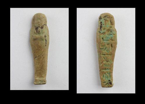 Nice Egyptian green faiance Ushabti with hieroglyphs, Late Period,