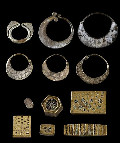 12 antique Thai or Laotian Tribal earrings and stamps, 16th-19th. cent