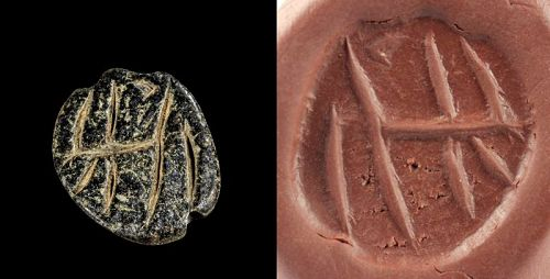 Black stone Mesopotamian stamp seal with animal, 4200-3400 BC