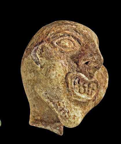 Roman pottery head w grotesque features, Egypt, ca. 1st.-3rd. cent.AD