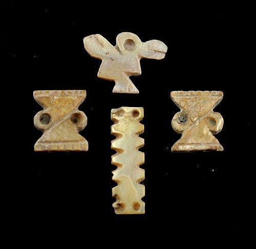 Set of four Spondylus shell pendants, Pre-Columbian, Chimú
