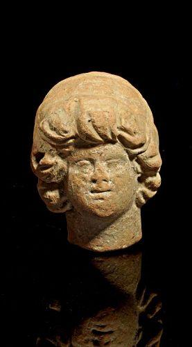 Nice rare Roman pottery head of female Deity, 1st.-3rd. century AD