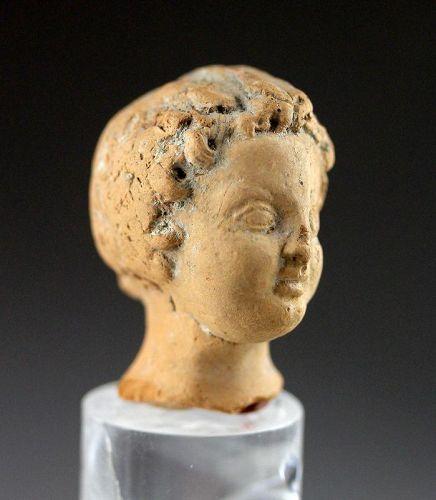Choice Roman pottery head of a Lady, 1st.-3rd. century AD