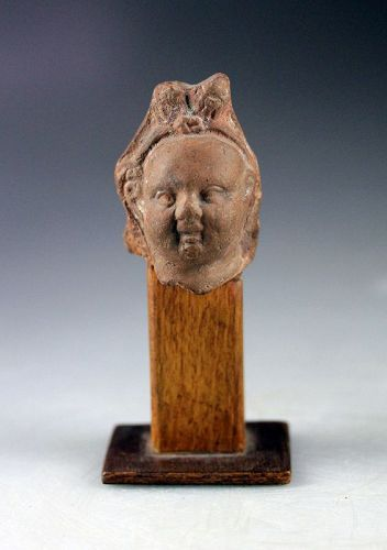 Greco-Roman Egypt, terracotta head of harpocrates, 3rd.-1st. c. BC