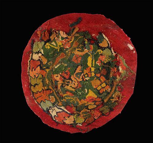Rare multi-coloured round textile fragment, Byzantine 7th.-8th. cent