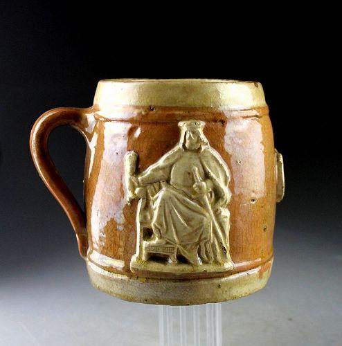 Rare massive European glazed stoneware mug with king, ca. 16th. c.