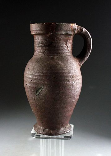 A nice brown glazed medieval Siegburg stoneware jug, 14. cent.