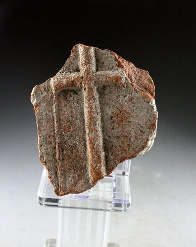 A Byzantine fragment of a ceramic brick with cross, 8th.-12th. cent.