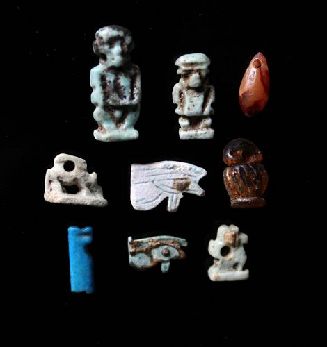 Collection of 9 ancient Egyptian gemstone, faiance and glass amulets