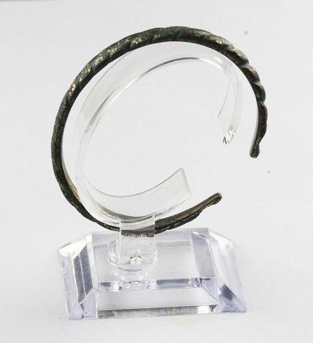 Nice twisted gilt bronze bracelet, Viking period, ca. 8th.-10th. cent