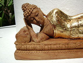 Hand carved wooden gilt reclining Buddha on throne