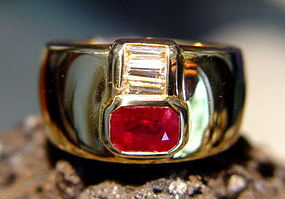Solid 18K. Gold Ring set with Ruby and tapered Diamonds