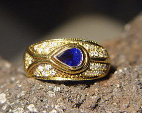 Solid 18K. Gold Ring with Blue Sapphire & Diamonds